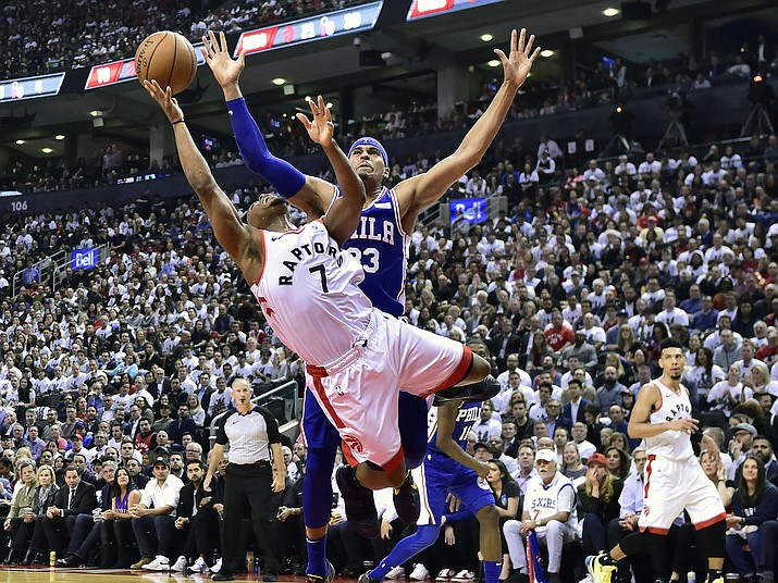 Toronto Raptors guard Kyle Lowry (7) draws a foul on Philadelphia 76ers forward Tobias Harris (33) as he drives to the net during second-half, second-round NBA playoff action in Toronto, Monday, April 29, 2019. (Frank Gunn/The Canadian Press via AP)