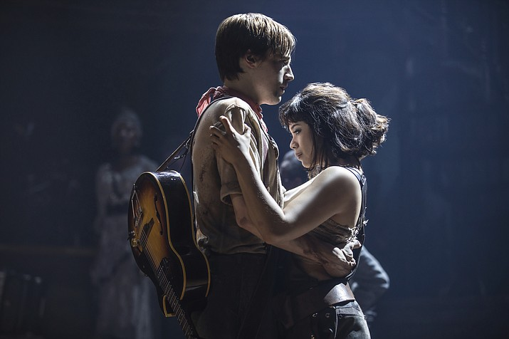 "This image released by DKC O&M Co. shows Reeve Carney, left, and Eva Noblezada during a performance of ""Hadestown,"" directed by Rachel Chavkin. (Matthew Murphy/DKC O&M Co. via AP)"