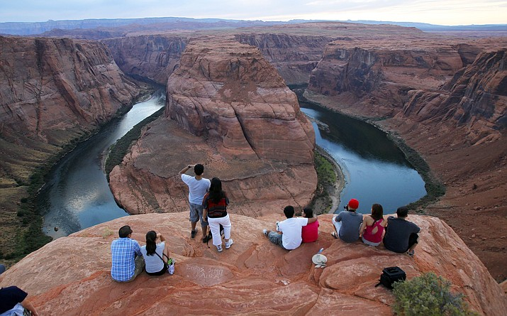 Page recently began charging $10 per vehicle at the base of a trail that leads to Horseshoe Bend along the Arizona-Utah border. Officials say it's needed to help control traffic and ensure safety. (AP Photo/Ross D. Franklin, File)