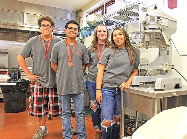 Jimi Gonzalez, Salvador Rosas, Jamie Donovan and Emily Ramirez competed at the Family Community and Careers of America cooking competion. Below: The students displayed their culinary skills at the competition held in Tucson. (Wendy Howell/WGCN)