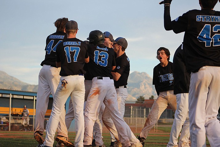 Kingman Academy celebrates after Kaden Bean's RBI single gave the Tigers a 1-0 victory over San Tan Foothills in the 3A Conference Play-In Tournament. (Photo by Beau Bearden/Daily Miner)