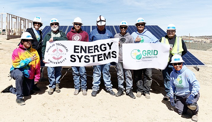 Members of GRID Alternatives pose with Navajo Technical University Instructor Ray Griego (third from right) and students after they completed the project at Ojo Encino community March 26-28. (Photo courtesy of Grid Alternatives Representative Sara Mayani Barudin)