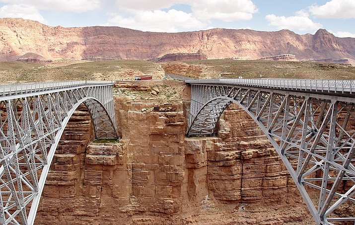 The new Navajo Bridge on the right replaced the original structure, left, which was completed in 1929. The original structure remains as a pedestrian bridge. (Photo/NPS)