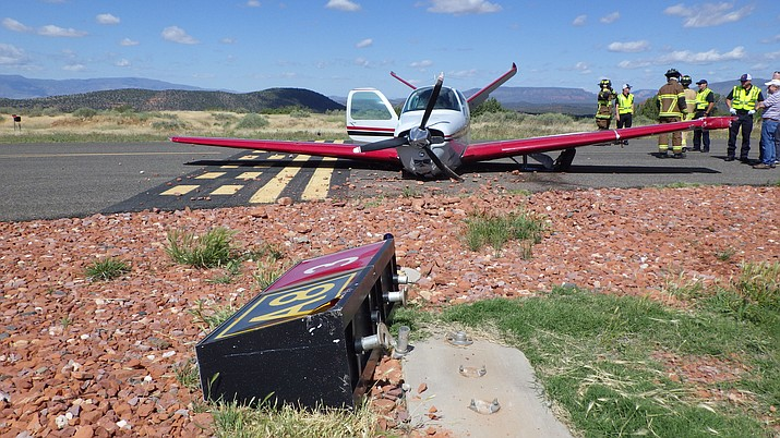 "Sedona Battalion Chief Buzz Lechowski said, ""The aircraft was upright although the impact had sheared off the landing gear."" The aircraft skidded across the infield and struck a runway sign before finally stopping on the taxiway. Sedona Fire District Courtesy photo"