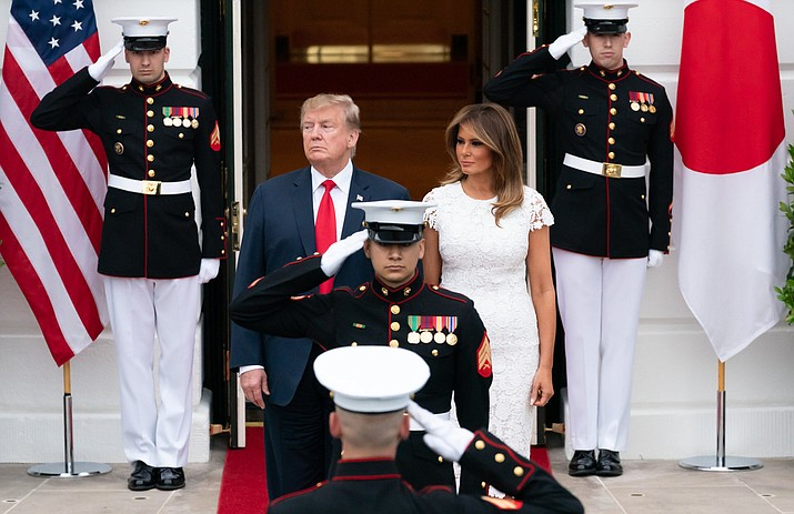 President Donald Trump and First Lady Melania Trump wait for the arrival of the Prime Minister of Japan Shinzo Abe and his wife Mrs. Akie Abe Friday, April 26, 2019, at the South Portico of the White House. As the Russia investigation threatened to shadow Donald Trump's presidency, he became increasingly concerned he would be seen as a cheater and a fraud. (Official White House Photo by Andrea Hanks)