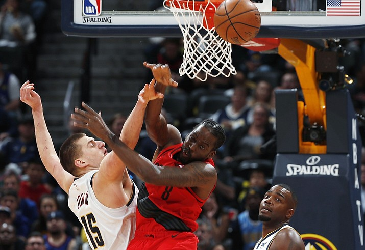 Denver Nuggets center Nikola Jokic, left, fights for control of a rebound with Portland Trail Blazers forward Al-Farouq Aminu during the first half of Game 2 of an NBA basketball second-round playoff series Wednesday, May 1, 2019, in Denver. (David Zalubowski/AP)