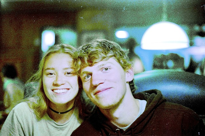 Riley Howell, right, is seen Sept. 1, 2017. Authorities say Howell, 21, was killed after he tackled a gunman who opened fire in a classroom at the University of North Carolina-Charlotte. Police said a few students, including Howell, died and several others were injured. Charlotte-Mecklenburg Police Chief Kerr Putney said Howell's actions likely saved the lives of other students. (Matthew Westmoreland via AP)