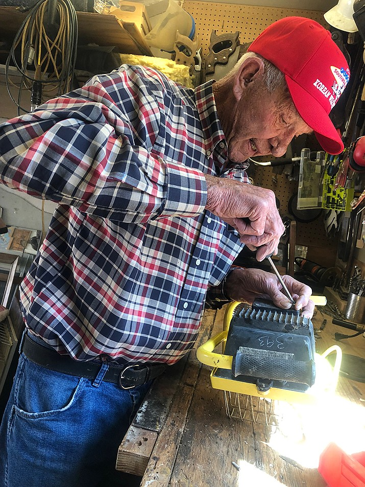 Steve Wood can fix anything but the crack of dawn and a broken heart. He is a Korean War veteran who will fly to Washington D.C. this weekend to be honored for his time of service. (Photo by Agata Popeda/Daily Miner)