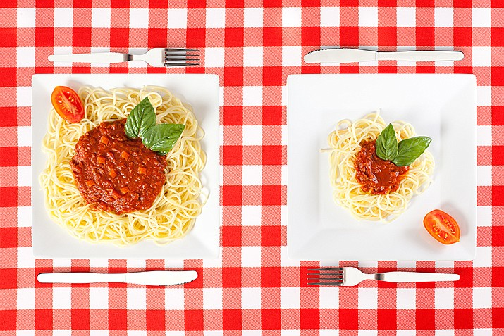 Research shows that how much a person eats at a given meal may be influenced by how much food is on the plate.Researchers at Penn State University served various portion sizes of macaroni and cheese to a selected group of people.They found that the amount consumed increased with portion size.(Adobe Image)