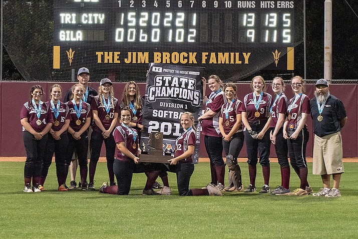 The Tri-City Preparatory softball team poses for a photo holding the Canyon Athletic Association state championship trophy and banner Saturday, April 27, 2019, in Tempe. Tri-City Prep. beat Gila Bend 13-9 for the title. (Tri-City Preparatory/Courtesy)