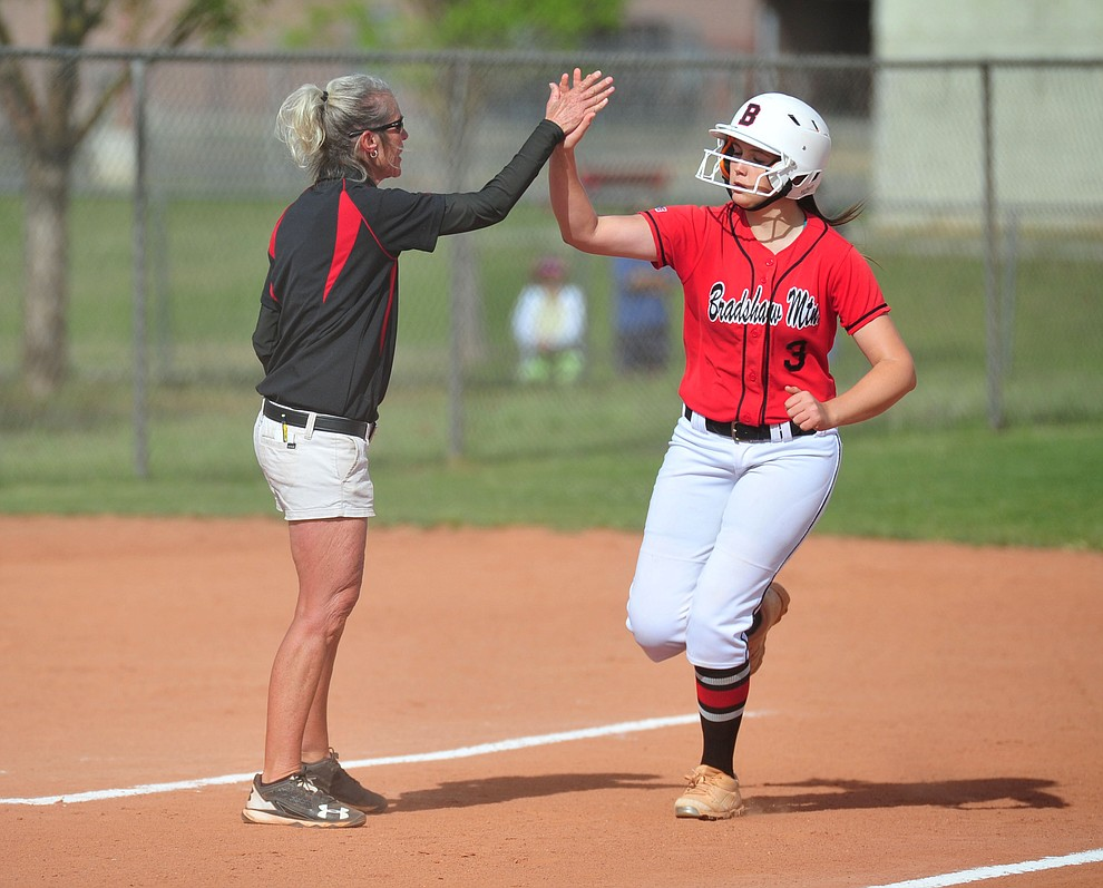 Bradshaw Mountain Head Coach Sharon Haese congratulates Madisen Duryea on her first inning two-run homer as the Bears host Canyon del Oro in the second round of the Arizona Interscholastic Association State Softball Tournament in Prescott Valley Thursday, May 2.  (Les Stukenberg/Courier)