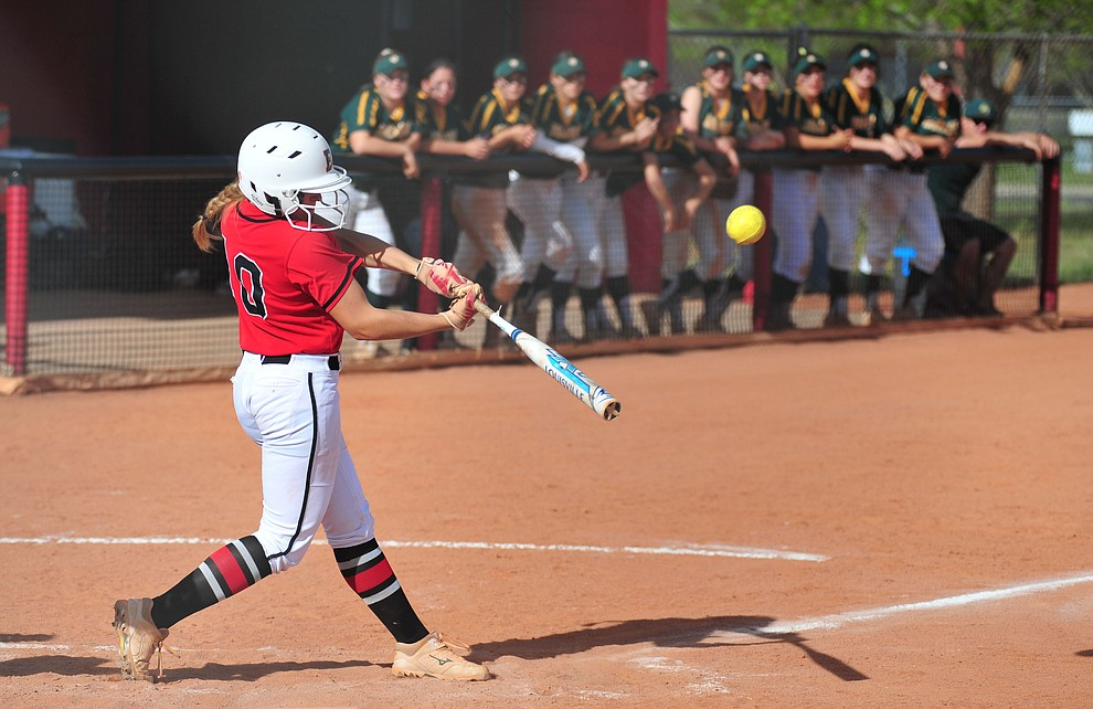 Bradshaw Mountain's Lyndsey Busch makes contact as the Bears host Canyon del Oro in the second round of the Arizona Interscholastic Association State Softball Tournament in Prescott Valley Thursday, May 2.  (Les Stukenberg/Courier)