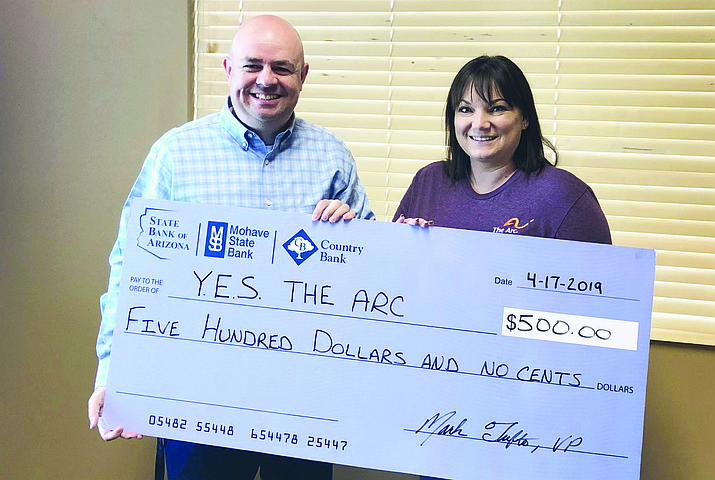 Country Bank presented a check to Y.E.S. The Arc for $500 on April 17, 2019 to help with programs that they provide for persons with developmental disabilities. Y.E.S. The Arc was founded on the belief that all people are capable of growth and learning. It is their goal to provide training and opportunities that will maximize growth towards the greatest independence possible for each individual. Pictured left to right are Mark Tufte, VP/Market Manager and Melanie Soto, executive director for Y.E.S. The Arc. Courtesy photo