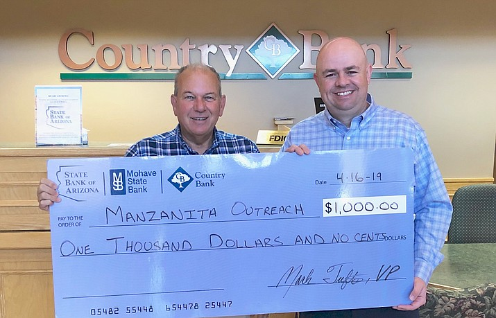 Country Bank presented Manzanita Outreach with a $1,000 check on April 16. The funds will support the mobile pantry services that Manzanita offers. Manzanita Outreach helps fill the gaps in food availability both locally and globally. Pictured left to right are Mike Newcomb, executive director, and Mark Tufte, VP/Market Manager for Country Bank. Courtesy photo