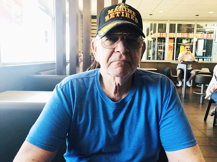 """Retired Marine Chuck Lowes said that since he """"run a helicopter to the ground in Vietnam a few times,"""" he is no stranger to VA facilities. Lowes has lost two veteran friends to suicide. (Photo by Agata Popeda/Daily Miner)"""