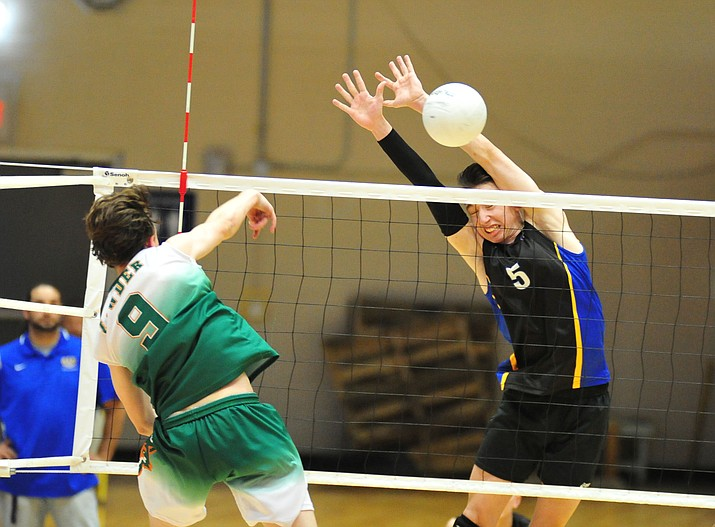 Prescott's Aydan McKenna gets a block as the Badgers host Campo Verde in boys volleyball Wednesday, April 3 in Prescott. McKenna and the Badgers were eliminated by Ironwood in the state play-in round on Thursday, May 2, 2019, in Glendale. (Les Stukenberg/Courier, file)