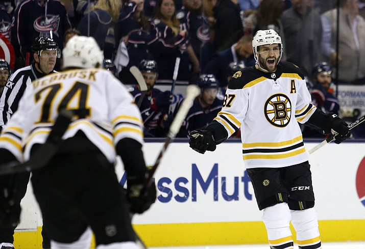 Boston Bruins forward Patrice Bergeron, right, celebrates his goal against the Columbus Blue Jackets with forward Jake DeBrusk during the first period of Game 4 of an NHL hockey second-round playoff series in Columbus, Ohio, Thursday, May 2, 2019. (Paul Vernon/AP)