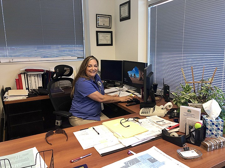 Mohave County Assessor Jeanne Kentch at work. Kentch is determined to make operations in the Mohave County Assessor's Office run smoother. (Photo by Agata Popeda/Daily Miner)