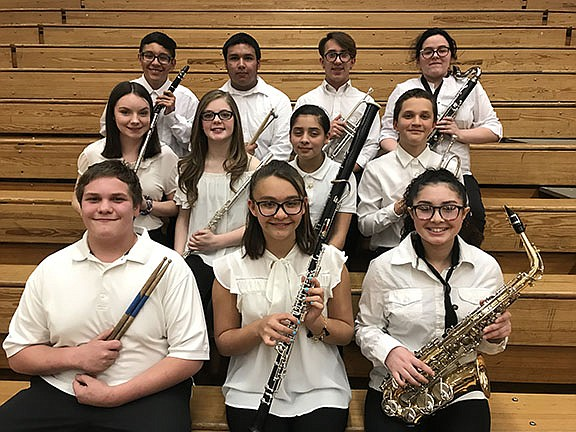 From left to right: front row: Chris Ross (percussion), Madison Guin (oboe), Sarah Abraham (alto saxophone). Second row: Emily Sumner (flute), Rylee Warren (flute), Alejandra Acuna (bassoon), Joseph McCoy (trumpet). Third row: Emmanuel Rosales Alejandre (clarinet), Cristo Velasquez (percussion), Apollo Ry-Allen Akres (trumpet), Hailey Murphy (bass clarinet). (Photo courtesy of Julie Gragg)