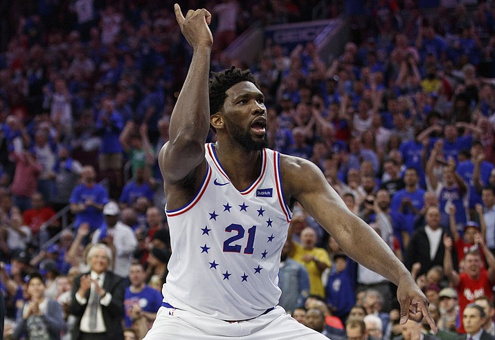 418993ccb2c8 NBA. Philadelphia 76ers  Joel Embiid reacts to his dunk during the second  half of Game 3