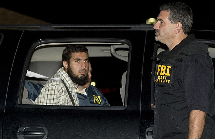In this Sept. 19, 2009 file photo, terrorism suspect Najibullah Zazi is seated in an FBI vehicle after being arrested by the FBI in Aurora, Colo. Zazi, who plotted to bomb New York City's subways, and then switched sides after his arrest and spent nearly a decade helping the U.S. identify and prosecute terrorists, was rewarded for his help Thursday, May 2, 2019 with a sentence of 10 years in prison, effectively time he has already served. (Chris Schneider/The Denver Post via AP, File)