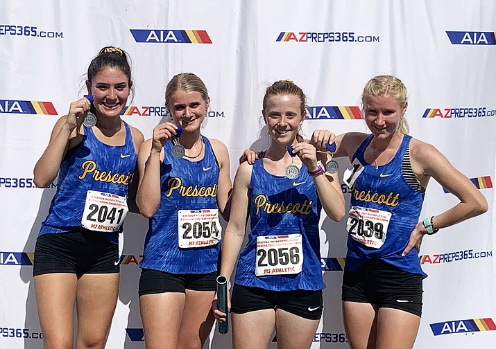 Prescott track and field's 4x800-meter girls relay team won the Division III state title by running a school-record time of 9:58.39 on Friday, May 3, 2019, at Mesa Community College. From left, the Badgers' Tea Castro, Cami McKelvey, Emily McMahon and Makenna Bray. (Cylinda Bray/Courtesy)