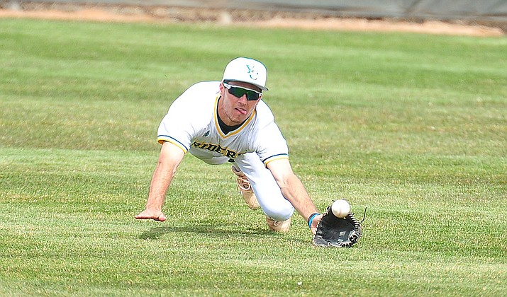 Yavapai's Gianni Tomasi makes a dive for the ball in center field March 26 in Prescott. Tomasi had a ball take a 'weird hop' in centerfield for an error that led to four runs being scored on one play in a 7-2 loss to South Mountain in Game 2 of the NJCAA Region I Playoff semifinals Friday, May 3, 2019, in Phoenix. (Les Stukenberg/Courier, file)