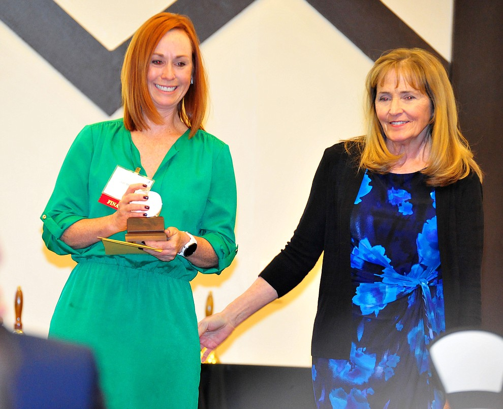 Abia Judd's Lori Markham receeives the K-2nd grade Teacher of the Year from Susan Clark as the Yavapai County Education Foundation held their 25th annual Teacher of the Year Banquet at the Prescott Resort Friday, May 3. (Les Stukenberg/Courier)