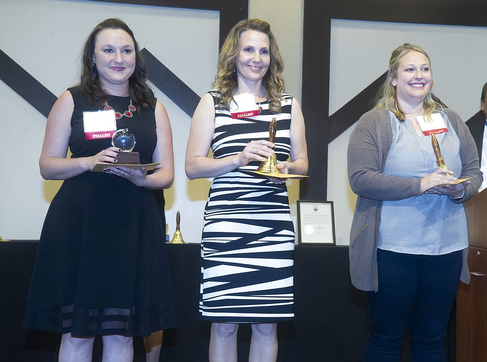 Del Rio Elementary's Jocelyn Hawkins, left, won as the 3rd - 5th grade Teacher of the Year with finalists Tabitha King and Haykee Kile as the Yavapai County Education Foundation held their 25th annual Teacher of the Year Banquet at the Prescott Resort Friday, May 3. (Les Stukenberg/Courier)