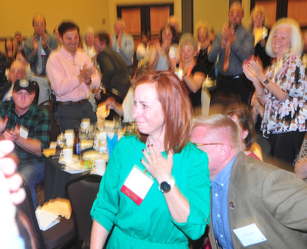 Abia Judd Elementary School's Lori Markham reacts after being named overall Teacher of the Year as the Yavapai County Education Foundation held their 25th annual Teacher of the Year Banquet at the Prescott Resort Friday, May 3. (Les Stukenberg/Courier)