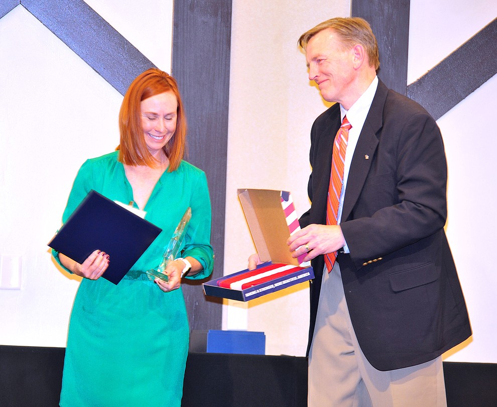 Abia Judd Elementary School's Lori Markham was named overall Teacher of the Year and receives a flag that flew over the United States Capital from U.S. Congressman Paul Gosar as the Yavapai County Education Foundation held their 25th annual Teacher of the Year Banquet at the Prescott Resort Friday, May 3. (Les Stukenberg/Courier)