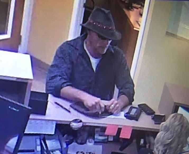The suspect pictured in this surveillance video is being sought by Prescott Valley Police for allegedly robbing the Credit Union West in Prescott Valley on Friday, May 3, 2019. He was last seen heading northbound on foot on Navajo Drive. For anyone with information on the suspect, please contact the Prescott Valley Police Department at 928-772-5114. Someone with information can also call Yavapai Silent Witness at 800-932-3232. (PVPD/Courtesy)