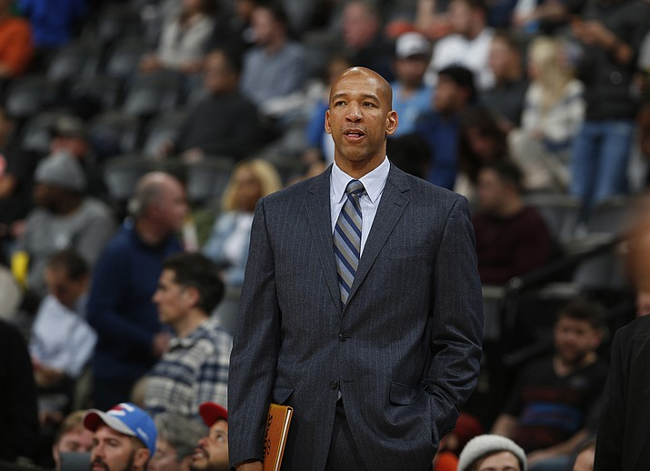 In this Jan. 19, 2016 file photo, then-Oklahoma City Thunder assistant coach Monty Williams watches during the second half of an NBA basketball game in Denver. The Phoenix Suns announced Friday, May 3, 2019, they have hired Williams as their new coach, replacing Igor Kokoskov, who was fired last week after one disappointing season. (David Zalubowski/AP, file)