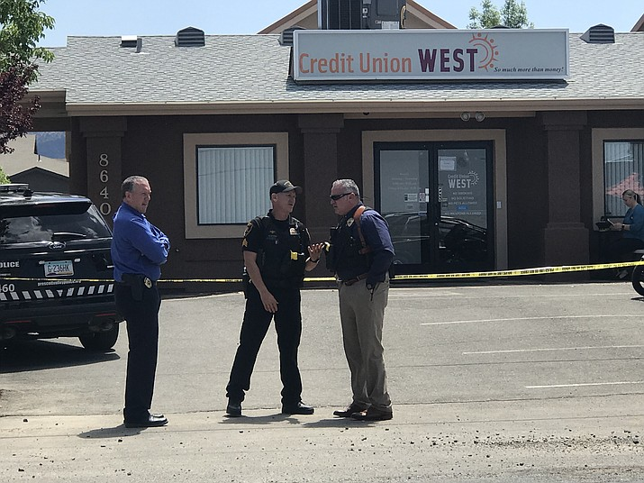 Prescott Valley Police at Credit Union West bank in Prescott Valley after it was robbed Friday, May 3, 2019. (Les Stukenberg/Courier)