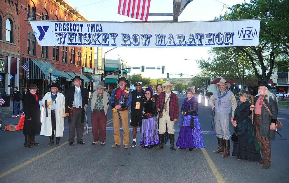 Prescott Regulators and their Shady Ladies pose for a photo during the 41st annual Whiskey Row Marathon  Saturday, May 4. (Les Stukenberg/Courier)