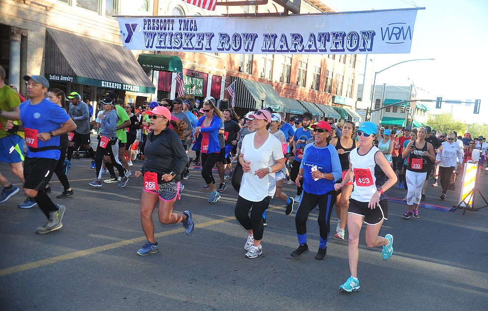 Half marathon runners begin on Montezuma Street during the 41st annual Whiskey Row Marathon  Saturday, May 4. (Les Stukenberg/Courier)