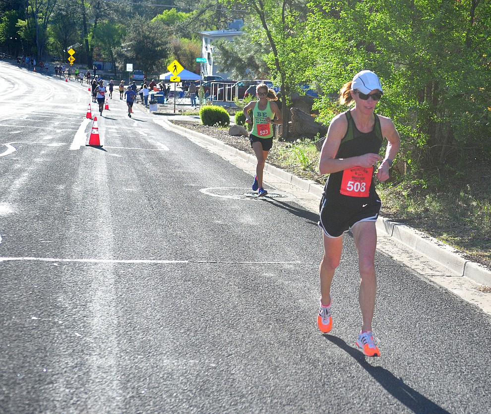 Prescott Valley resident and Bradshaw Mountain High School teacher Randi O'Neill heads up Gurley Street in the half marathon during the 41st annual Whiskey Row Marathon  Saturday, May 4. (Les Stukenberg/Courier)