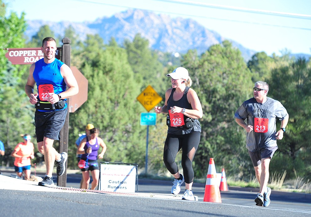 Half-marathon runners head up Copper Basin with Granite Mountain in the background during the 41st annual Whiskey Row Marathon  Saturday, May 4. (Les Stukenberg/Courier)