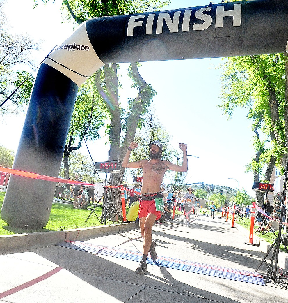 Prescott resident Michael Versteeg wins the marathon at the 41st annual Whiskey Row Marathon  Saturday, May 4. (Les Stukenberg/Courier)