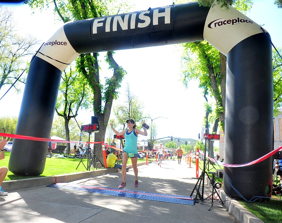Tempe's Kassidy Bennett wins the womens marthon during the 41st annual Whiskey Row Marathon  Saturday, May 4. (Les Stukenberg/Courier)