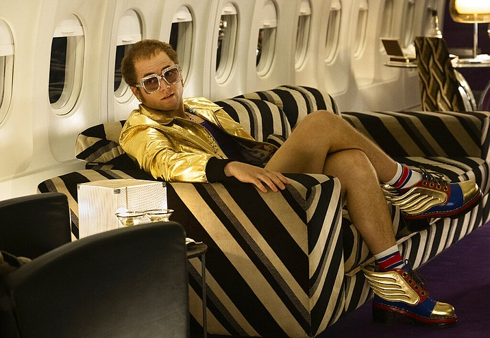 "This image released by Paramount Pictures shows Taron Egerton as Elton John in a scene from ""Rocketman."" (David Appleby/ Paramount Pictures via AP)"