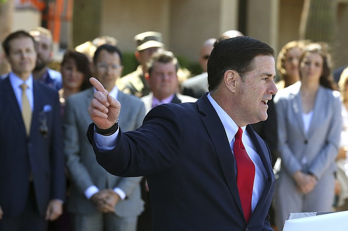 Gov. Doug Ducey at the Arizona Capitol on April 10, 2019, in Phoenix. Ducey is one step closer to getting what he wants, about $155 million in state taxpayer money thanks to changes in the tax code. (Ross D. Franklin/AP, file)