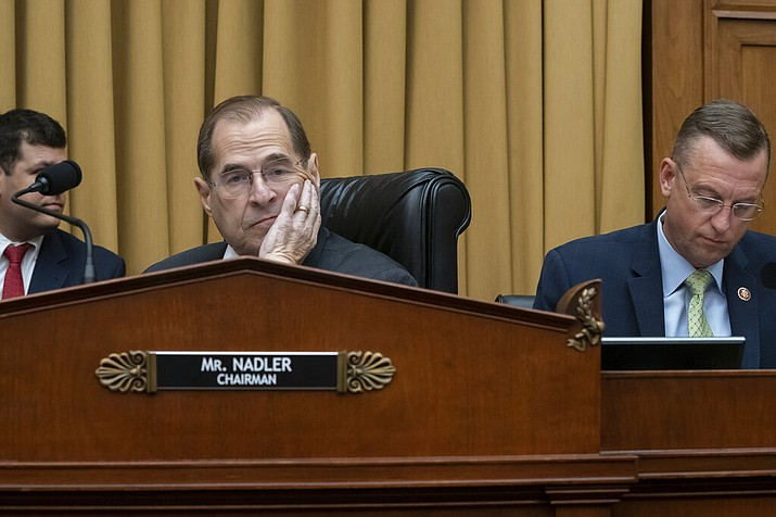 House Judiciary Committee Chair Jerrold Nadler, D-N.Y., joined at right by Rep. Doug Collins, R-Georgia, the ranking member, waits to start a hearing on the Mueller report without witness Attorney General William Barr who refused to appear, escalating an already acrimonious battle between Democrats and the Justice Department, on Capitol Hill in Washington, Thursday, May 2, 2019. (AP Photo/J. Scott Applewhite)