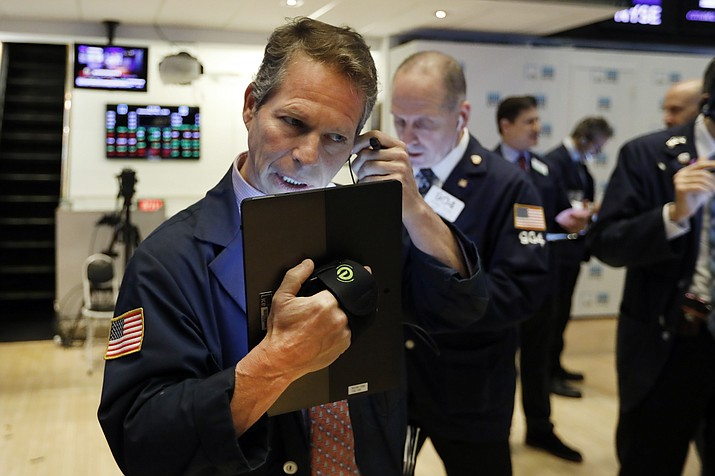 In this May 1, 2019, file photo, trader Robert Charmak, left, works on the floor of the New York Stock Exchange. On Monday, May 6, U.S. stocks plunged at the opening of trading, following a sell-off in global markets, after President Donald Trump threatened to escalate a trade war between the world s two largest economies. (Richard Drew/AP, File)