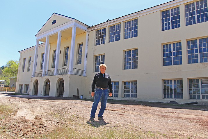 Bruce Bennett has converted six rooms into apartments at the old yellow school in Williams. Bennett is now working on 16 more apartments on the second and third floors. (Wendy Howell/WGCN)