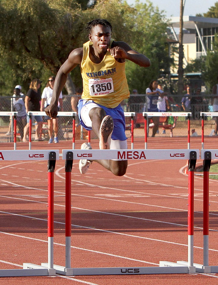 Kingman High's Jamal Cash ran a 40.57 to take third in the 300-meter hurdles Saturday at the Division III State Track and Field Championships. (Photo courtesy of Oscar Perez/Pinal Central)