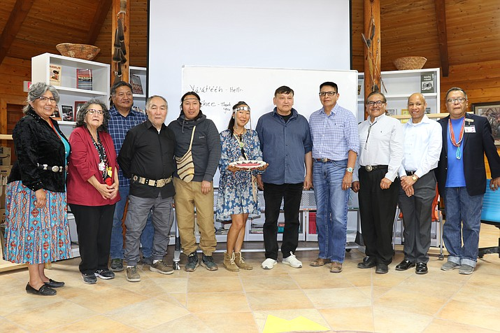 Navajo Technical University's Diné Studies students and university officials pose with the Yakut group after a gift exchange. NTU President Dr. Elmer J. Guy presented the group with a traditional Navajo wedding basket. (Photo courtesy of NTU)