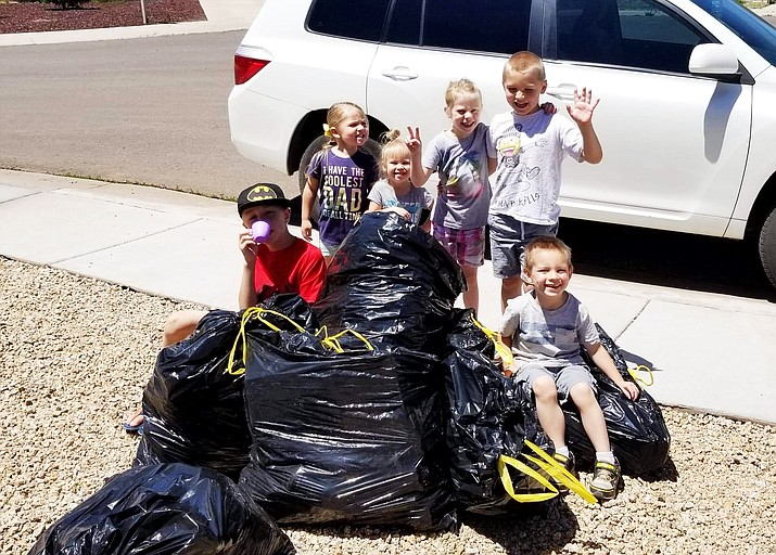 The Richard's and Anderson kids help clean up May 4 at the Spring Clean-up day. (Photo/Kerry Lynn Moede)