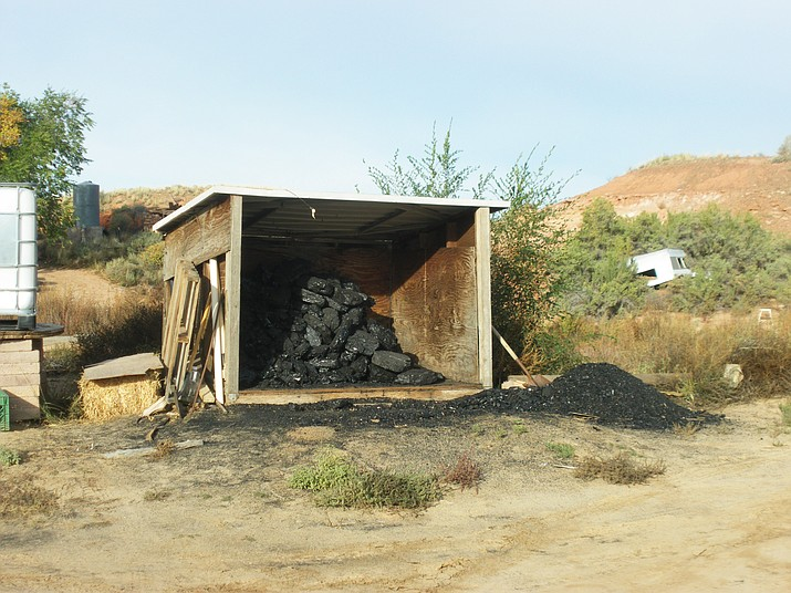Coal is stored at a Hopi Home in Hotevilla Village on the Hopi Reservation. (Photo courtesy of Morgan Miles Craft)