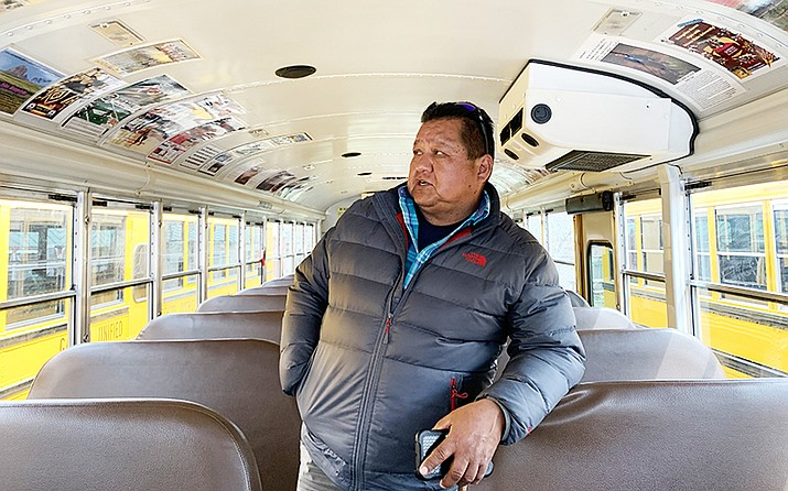 Freddie Yazzie puts pictures of local legends in his school bus, which he calls the Legacy of Excellence. (Photo by Jake Goodrick/Cronkite News)